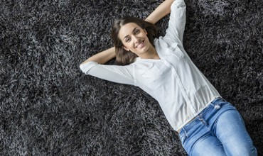 Girl laying on black Carpet | Design Waterville